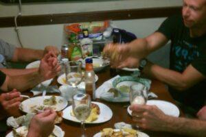 boys enjoying seafood feast